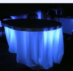 Under Table LED Blue Light. A stunning idea for decoration tables for a winter sweet 16 birthday party.