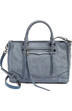 Currently crushing on this Rebecca  Minkoff satchel in dusty blue. Supersoft nubuck leather set off by signature stud hardware and dangling tassels makes this beauty the perfect go-to.