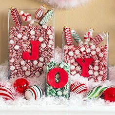 Peppermint Greeting  Turn your home into a candy land with yummy sweets. Fill glass containers with red and green peppermints. Cut out letters spelling a Christmas greeting, and secure them to the containers with tape. Place the display on a mantel or side table for a decoration everyone will want to sink their teeth into.