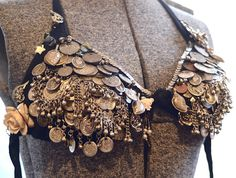 Kristine's coin bra. Love the flowers and other charms.
