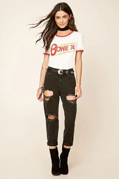 A pair of distressed boyfriend jeans with a high-waisted fit, a five-pocket construction, and a zip fly.