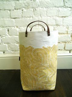 Oh how I would love this! MH (From Etsy; Medium block printed hamper with leather handles in Burrows, store is paptoro)