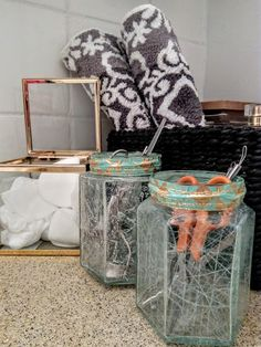 Upcycled glass jars for a cracked effect. Fun DIY bathroom storage and decor.