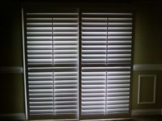 A Plantation Shutter slider was built for a sliding glass door. The 2 large panels and the louvers are pictured closed here. It is an attractive solution for a difficult opening to cover. Decor, Sliding Glass Door, Southern Accents, Large Panel, Blinds, Paneling, Furnishings, Window Treatments, Shutters