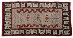 With an interesting use of orange and red, this Mid-century Navajo Teec Nos Pos tapestry brought out the bidders, earning $9,600 at Moran's May 30 American West Auction (est. $3,500 to $4,500). John Moran Auctioneers image.