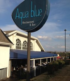 Aqua blue Nightly Specials Boast Half-Price Bottles of Wine, Sushi and Drink Deals  and Live Music
