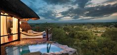 Leopard Hills is a stunning retreat built on a hill with superb views overlooking Sabi Sand game reserve in South Africa. The luxury lodge consists of eight luxurious glass-fronted suites, complete with their own sun deck and rock plunge pool with br Dream Vacations, Vacation Spots, Beach Paradise, The Places Youll Go, Places To Visit, Places To Travel, Travel Destinations, Sand Game, Chobe National Park