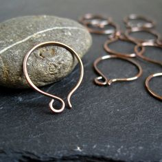 Copper Hoop Earwires- Using a different metal type with your ear wires can offer new design options for your pieces. In this pair, pure copper is shaped into a small hoop wire and lightly oxidized and filed at the ends for a smooth comfort finish.