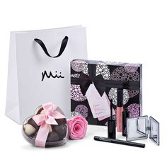 The special women in your life are sure to delight in this feminine gift set featuring luxurious makeup, Godiva heart shaped chocolates, and an