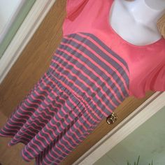 """Pink & gray striped hi-lo dress Pink and gray striped high-low dress with cap sleeves. Size 3 from Target. Good used condition. 29"""" from armpit to armpit, 35"""" from armpit to the longest part of the hem. 95% polyester 5% spandex, the top is 100% polyester Xhilaration Dresses High Low"""