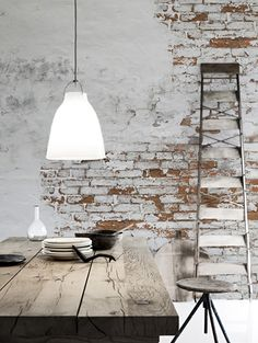 An exposed brick wall in a room doesn't always mean industrial. Moreover if we talk about the specific white brick wall, the style and design it suits will be way more than just one kind. The range is wide as . Design Industrial, Industrial Living, Industrial Interiors, Industrial Style, Kitchen Industrial, Vintage Industrial Decor, White Brick Walls, Exposed Brick Walls, Painted Brick Walls