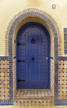 4616- Asilah-4616 copie | Flickr; Blue door, tiled doorway, metal hinges and nailheads
