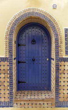 4616- Asilah-4616 copie | Flickr; Blue door, tiled doorway, metal hinges and nailheads