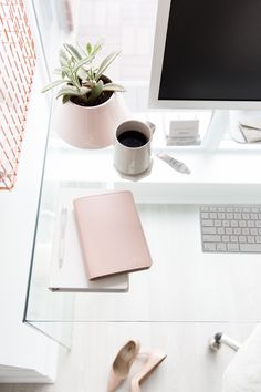 I love this style! Glass work desk, some coffee, a succulent (of course) and light pink accents make for the perfect simple, minimalist decor for your home office.