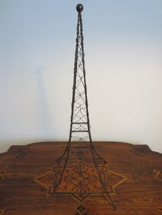 A charming wire art , a folk modernist black wire metal, inspires Eiffel Tower of Paris , an impulse for decorating with impressive round finial, stand, vintage