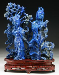 """A Fine Chinese Antique Carved Lapis Lazuli Figure Group: finely carved from the stone of fine deep cobalt coloration as two figures, presented on a wood stand  Dimensions: H: 8""""; (overall) H: 10"""""""
