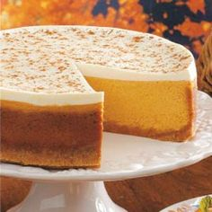 Pumpkin Cheesecake with Sour Cream Topping Recipe  I make this pumpkin cheese cake recipe every Thanksgiving (except I use 1 cup sugar and 1/4 cup packed brown sugar and only 3/4 cup of canned milk) Its a HUGE hit! everyone loves it!   I think this year I will try the topping as well!! YUM!!