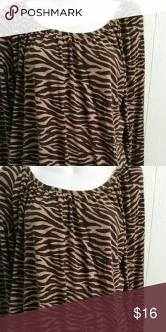 Michael Kors blouse Michael Kors tiger striped blouse used gently in great conditions. Michael Kors Tops Blouses