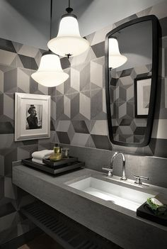 Geometric patterns coupled with curved lighting can create a contrast of interesting features to add depth to your walls.