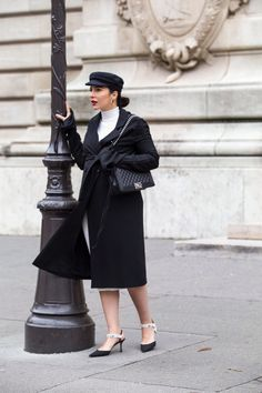 Black Trench Dress worn with baker boy hat, slingbacks and Chanel Boy Bag by For John Galliano SS 18 Show At PFW - by Stella Asteria, Fashion & Lifestyle Blogger