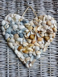 """DE GULLE AARDE: shells glued onto a cardboard heart ("""",)"""