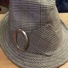 Black and white fedora Black and white plaid/checkered fedora with silver buckle on one side. Accessories Hats