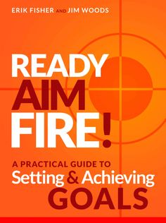 """Nicole picked up """"Ready Aim Fire!: A Practical Guide To Setting And Achieving Goals"""" by Erik Fisher, Jim Woods"""
