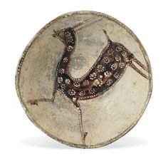 A FIGURAL CONICAL POTTERY BOWL  EASTERN IRAN, 10TH CENTURY  On short flat foot, rimless, the slip painted decoration with a stylized gazelle, its coat decorated with dotted roundels, the bowl's lip highlighted in brown with white dots, repaired breaks 8in. (20.7cm.) diam.