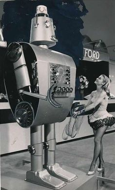 """""""Freddie Ford"""" the robot answers questions fed to it by curious visitors. Robot was formed from Ford car parts and stands tall. Vintage Robots, Retro Robot, Science Fiction, Vintage Photographs, Vintage Photos, Vintage Space, Cyberpunk, Arte Nerd, Arte Robot"""