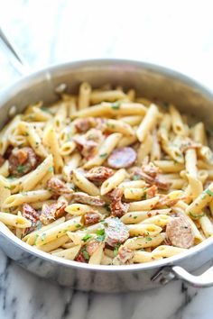 Pasta is one of my all-time favorite comfort foods — there are so many ways to enjoy it! In fact, did you know that there are more than 600 different pasta shapes? So in honor of National Pasta Day on Oct. here are 20 pasta recipes you can enjoy… Sun Dried Tomato Sauce, Sundried Tomato Pasta, Tomato Cream Sauces, Tomato Tomato, Sausage Recipes, Cooking Recipes, Sauce Spaghetti, Creamy Pasta Recipes, Easy Pasta Dishes