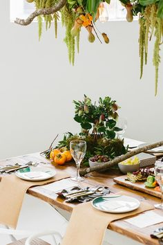 Modern woodland wedding reception centrepiece with exotic fruits and flowers | Fifteen Photography