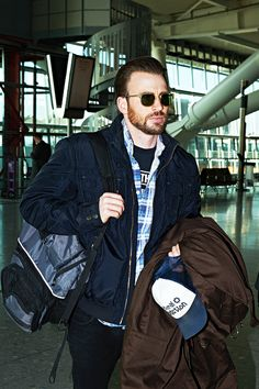 February 2015 - Chris Evans, has his hands full as he heads for a flight departing from London's Heathrow Airport on Monday. Sebastian Stan, Chris Captain America, Robert Evans, Nicholas Hoult, Star Track, Mark Ruffalo, Lee Pace, Stucky, Michael Fassbender