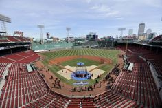 Boston Red Sox players surround the batting cage during pre-game warm-ups before the Red Sox baseball Home Opener against the Pittsburgh Pirates at Fenway Park, Monday, April 3, 2017, in Boston. (AP Photo/Elise Amendola)