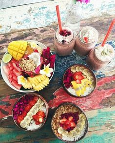 Smoothie: -strawberry -blueberry -banana toppings: pitaya, banana, mango, seeds, strawberry, & granola on the side- watermelon, dragon fruit, mango, banana, lime