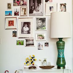 """Four generations of family photos mix with a thrift-store lamp and a wooden molecule ball set. The takeaway? Make sure your rooms have something to say and that they mean something to you. -From """"The Organized Home"""" by Sunset magazine"""