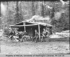 Klondike Gold Rush, cabin, wood, gold diggers, working men, photo, black and white, history