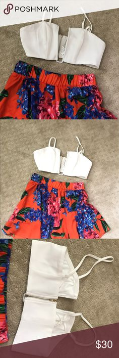 White Crop Top Super cute white crop top. Looks adorable paired with these show me Your Mumu shorts (also for sale). zipper back. Adjustable straps. Aus size 6 is equivalent to a US xs. NWT Tops Crop Tops