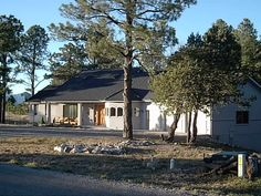 Rydholm Residence, Alto Lakes Golf and Country Club, Deer Meadows area, Alto, NM. A traditional mountain home strategically placed in a dense stand of tall Ponderosa Pine.