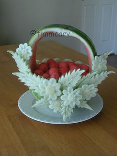 A watermelon fruit basket carving decorate with melon peels that carve of flowers and leaves garinsh on the side. Fruit Basket Watermelon, Watermelon Art, Watermelon Carving, Edible Crafts, Edible Food, Edible Art, Veggie Art, Fruit And Vegetable Carving, Veggie Food