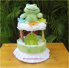 Diaper Cake Carousel by calidelights on Etsy. , via Etsy. Size 1 Diapers, Unique Diaper Cakes, Green Frog, Baby Arrival, Baby Shower Centerpieces, Wood Wall Decor, Baby Rattle, Receiving Blankets, Wishing Well