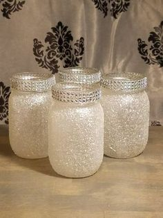 Pint size mason jars glittered with fine iridescent white glitter with diamond wrap around the mouth of the jar. These are small 16 oz jars that are sealed to prevent the glitter decorations from being removed. These jars a the perfect small centerpieces. Mason Jar Christmas Crafts, Mason Jar Crafts, Diy Christmas, Magical Christmas, Christmas Ornaments, Holiday, Glitter Mason Jars, Painted Mason Jars, Glitter Wine