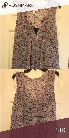 Floral Motherhood Maternity Tank Top Very cute floral motherhood Maternity top. The top is a sleeveless babydoll type top and the material flows very well. Gently worn. Motherhood Maternity Tops Blouses