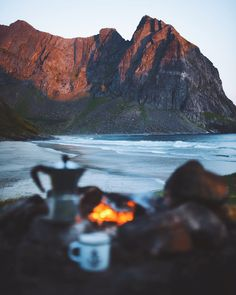 Such a silent moment. Only those small waves breaking on the shore and a light breeze making the dying fire glow. Lofoten, Breeze, Norway, Sunrise, Travel Photography, Glow, Waves, Journey, Fire