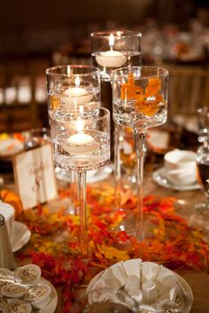 Candles with a warm and beautiful fall setting, could make green, either way a stunning center piece