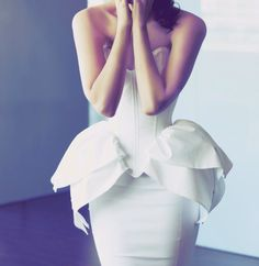 White Sculptural peplum dress