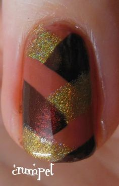 fishtail braid over terracotta manicure