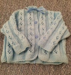 Little knitted wool baby cardigan. Cardigan is finished with a ribbon tie and buttons. Knitted Baby Cardigan, Baby Steps, Uk Shop, Baby Knitting, Handmade Items, Wool, Etsy, Shopping, Tricot Baby