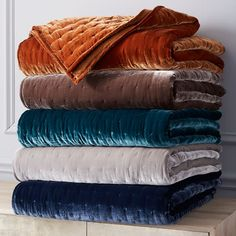 EITHER THE BLUES, OR THE ORANGE, WHICHEVER BRIGHTCOLOR YOU WANT TO GO WITH...  Luxe Velvet Quilt | west elm