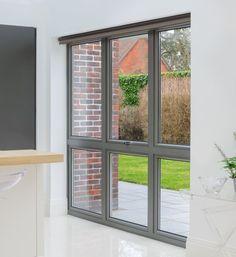 An external view of Origin's casement windows looking into a lounge