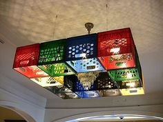 Milk crate chandelier this would  be awesome in a basement tv room or man cave poker room!!!!!!!!!